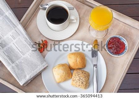 Breakfast including coffee, bread, orange juice. - stock photo