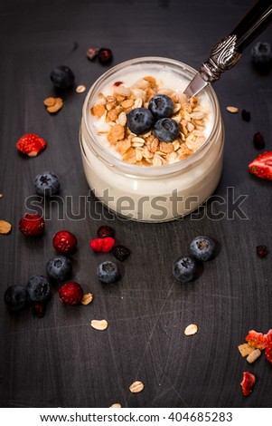 Breakfast of yogurt, muesli and blueberry. Healthy food for breakfast. Top view - stock photo