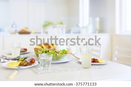 Breakfast on a white table - stock photo