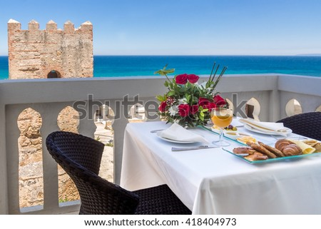 Breakfast on terrace with view on sea - stock photo
