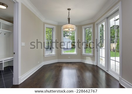 Breakfast room in new construction home with mud room view - stock photo