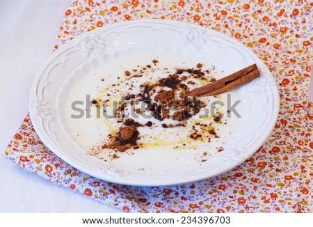 Breakfast semolina porridge with cocoa chocolate and honey home food health selective soft focus - stock photo