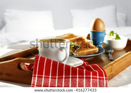 breakfast time in bed and coffee napkin and fresh food  - stock photo