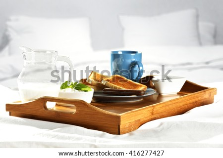 breakfast time in bed and free place and milk and bread and home interior  - stock photo