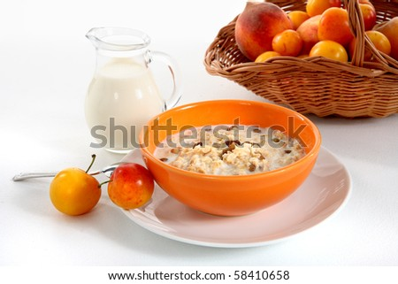 Breakfast. view of the Corn Flakes and milk, peach - stock photo