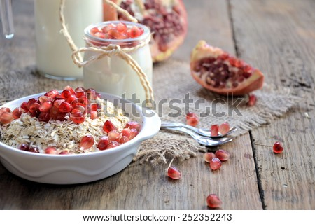 Breakfast with a pomegranate - stock photo