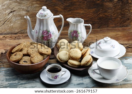 Breakfast with black coffee and cereal biscuits - stock photo