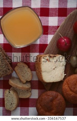 Breakfast with bread, radish, olives, cheese and juice. Shallow depth of field, vintage style. - stock photo