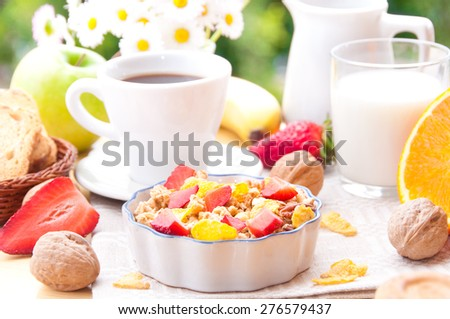 Breakfast with  cereals, coffee, milk and fruit - stock photo