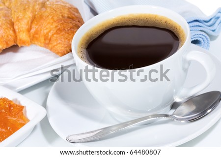 breakfast with coffee and croissant - stock photo