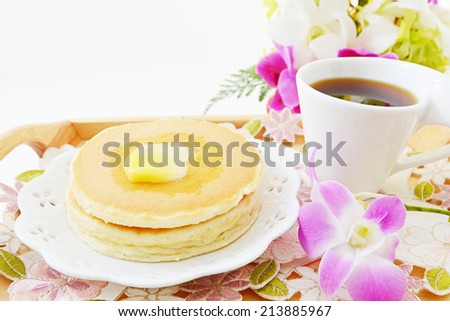 Breakfast with coffee and pancakes - stock photo