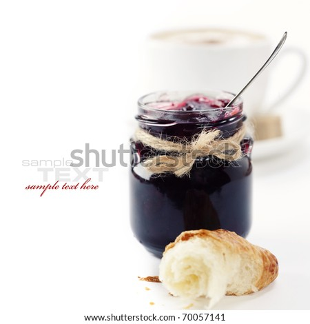 Breakfast with coffee, croissant and jam (easy removable text) - stock photo