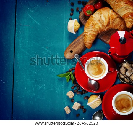 Breakfast with coffee, croissants and berries. Blue background - stock photo