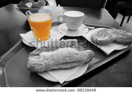 Breakfast with coffee, juice and pastries in black and white and selective de-saturation - stock photo