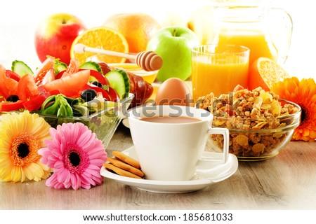 Breakfast with coffee, juice, croissant, salad, muesli and egg. Swedish buffet - stock photo