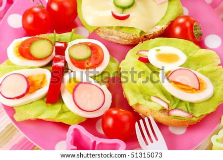 breakfast with cottage cheese for child with butterfly and chicken  shape sandwich - stock photo