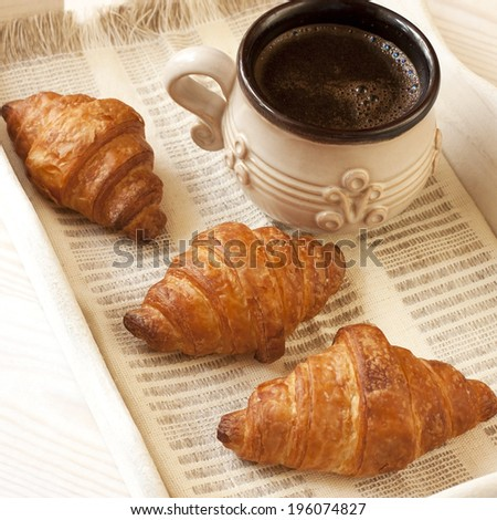 Breakfast with croissant and coffee cup - stock photo