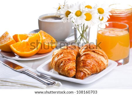 breakfast with croissants, orange juice and coffee - stock photo