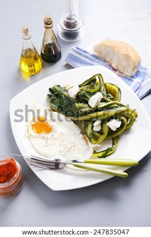 breakfast with eggs & fresh herbs - stock photo