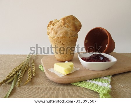 Breakfast with flowerpot bread and redcurrant jelly - stock photo
