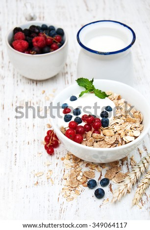 breakfast with fresh berries on a wooden table - stock photo