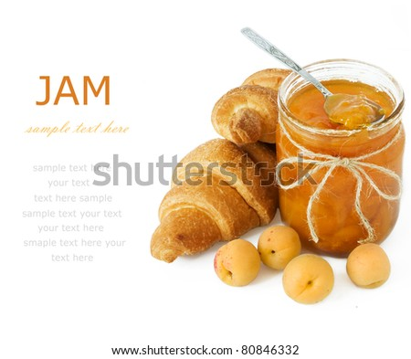 Breakfast with fresh croissants, apricots and jam isolated on white with sample text - stock photo