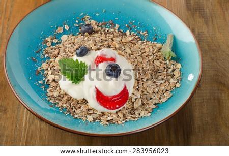 Breakfast with fresh yogurt, berries and muesli. Selective focus - stock photo