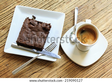 Breakfast with freshly brewed coffee and brownie on the wooden table natural background - stock photo