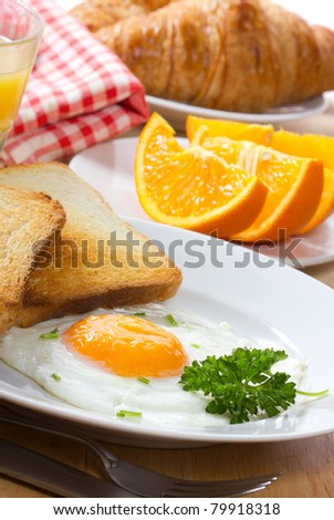 breakfast with  fried egg,  juice and croissant - stock photo