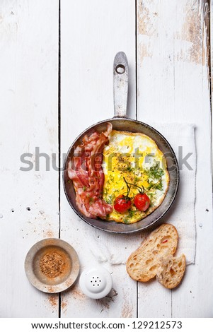 Breakfast with Fried eggs and bacon on pan - stock photo