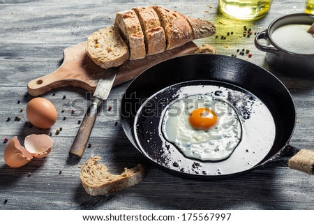 Breakfast with fried eggs and bread - stock photo