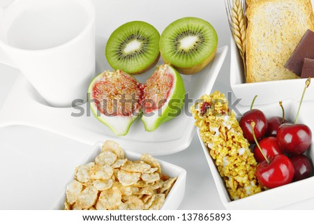 Breakfast with fruits and energy bar - stock photo
