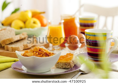 Breakfast with juice, fruits, jam and eggs - stock photo