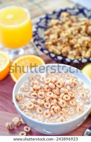 Breakfast with milk, cereals an orange juice - stock photo