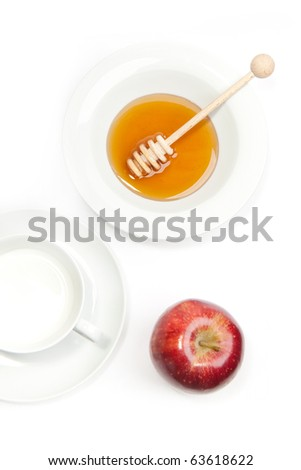 Breakfast with milk, honey and apple on a white background - stock photo