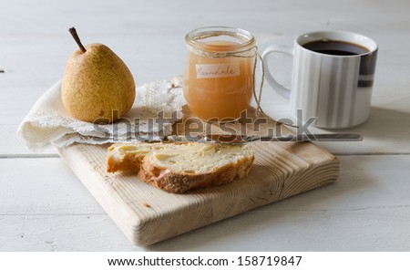 Breakfast with pear jam and bread - stock photo