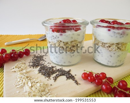 Breakfast with yogurt, chia seeds, oatmeal and berries - stock photo
