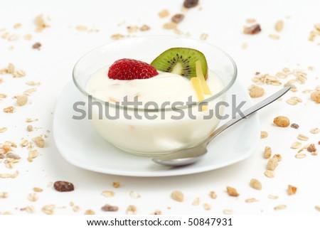 breakfast yogurt with a strawberry and kiwi in a glass bowl - stock photo