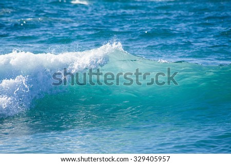 breaking foamy waves by the shore of Gran Canaria - stock photo