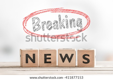 Breaking news sign made of wood with a red sketch - stock photo