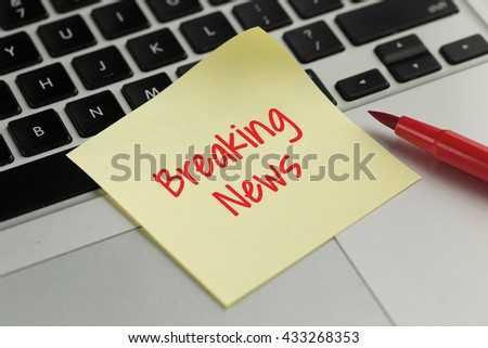 Breaking News sticky note pasted on the keyboard - stock photo