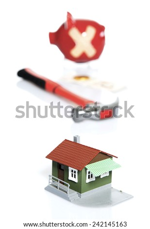 Breaking the Piggy Bank for Home loan concept - stock photo