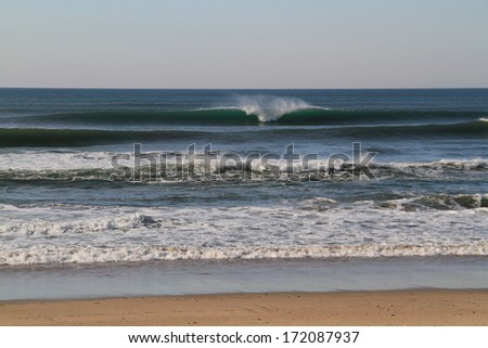 Breaking wave in empty line-up, Agucadoura, Portugal - stock photo