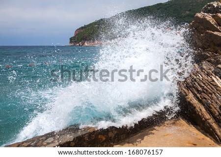 Breaking wave on Adriatic Sea coast in Montenegro - stock photo