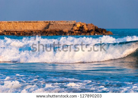 breaking waves at coastal line in Sitges, Spain. - stock photo