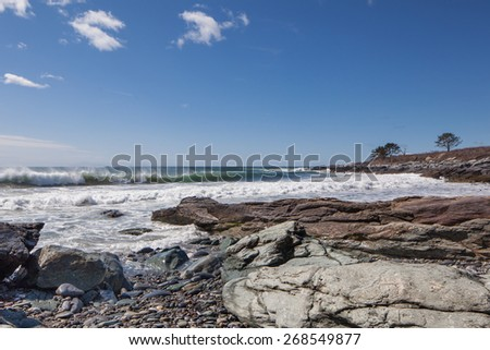 Breaking waves at Sachuest Point.  Taken on a sunny spring day with big surf. - stock photo