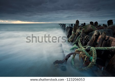 breakwater in the storm - stock photo