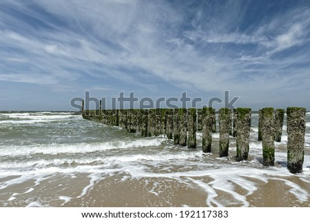 Breakwaters in the sea, Netherlands - stock photo