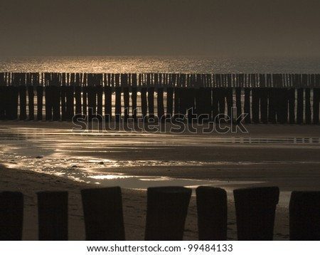 breakwaters on the beach of Cadzand in the Netherlands - stock photo
