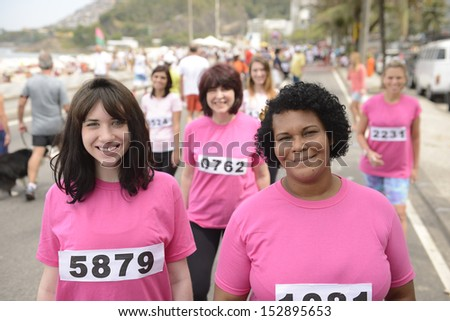 Breast cancer awareness charity race: Women in pink - stock photo